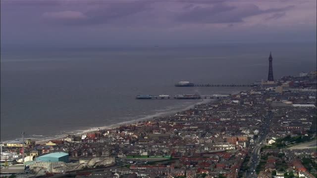 aerial golden mile and amusement park/ blackpool, england - blackpool stock-videos und b-roll-filmmaterial