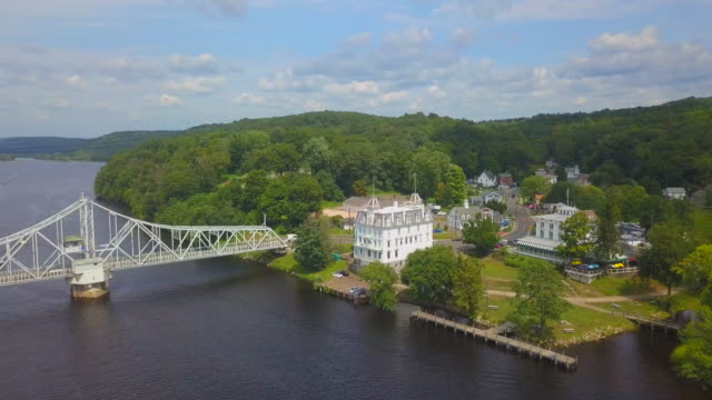 aerial: goodspeed opera house with town and swing bridge on connecticut river - swing bridge stock videos & royalty-free footage