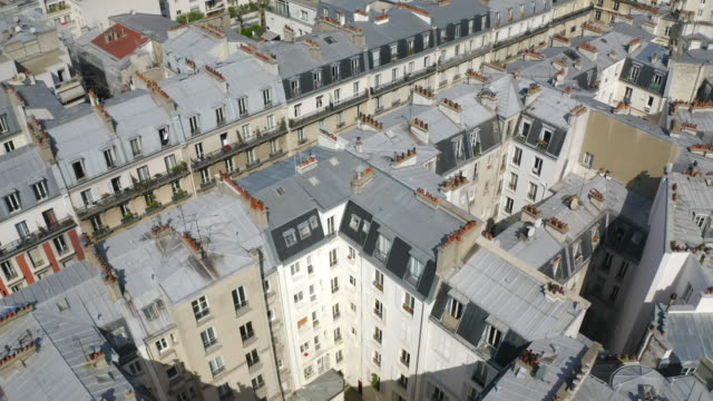 vidéos et rushes de aerial: gothic church among modern houses  - paris, france - paris