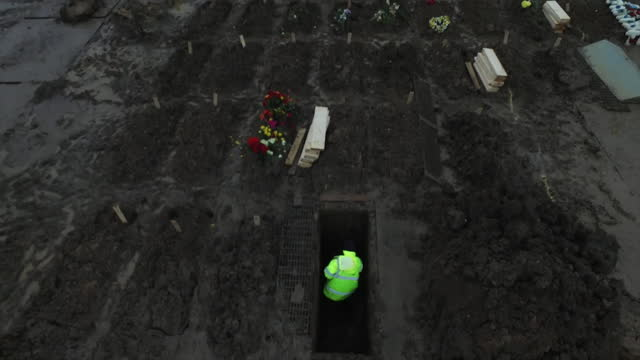 "aerial grave being dug in london cemetery during coronavirus pandemic - ""bbc news"" stock videos & royalty-free footage"