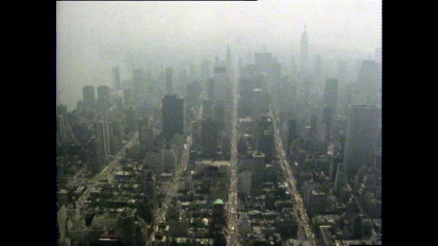 aerial gvs of new york cityscape and empire state building - film montage stock videos & royalty-free footage