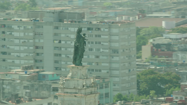aerial havana, cuba, circling our lady of carmen church sculpture atop steeple - steeple stock videos & royalty-free footage
