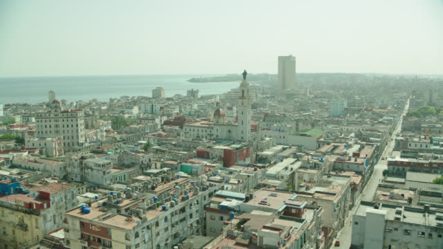 aerial havana, cuba, featuring our lady of carmen church sculpture atop steeple - steeple stock videos & royalty-free footage