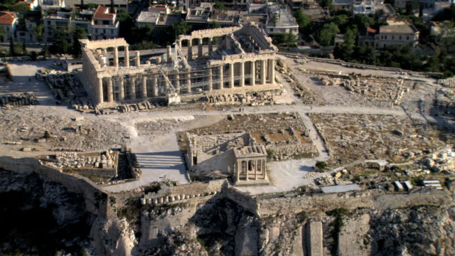 aerial hd video of the acropolis focusing on the parthenon the house of the goddess athena / acropolis, athens, greece - acropolis athens stock videos and b-roll footage