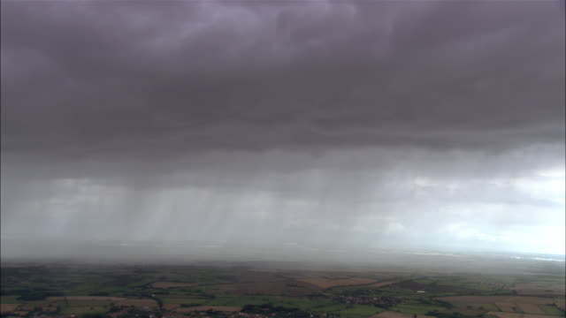 aerial heavy storm clouds and sheets of rain over fields / leicestershire, england - europe stock videos & royalty-free footage