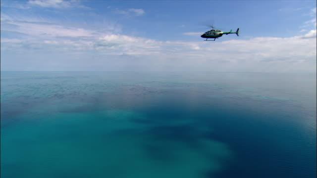 vidéos et rushes de aerial helicopter over water/ miami, florida - un seul objet