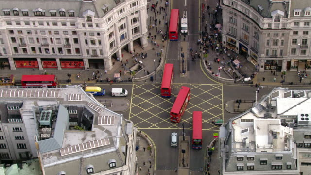 aerial high angle pan buses turning through oxford circus / london, england - crossing stock videos & royalty-free footage