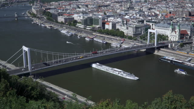 aerial high angle view of suspension history bridge in budapest, hungary, elisabeth bridge, and szechenyi chain bridge. many transportations, car, bus, nautical vessels along the danube river. concept of travel destination with urban skyline. - chain bridge suspension bridge stock videos & royalty-free footage