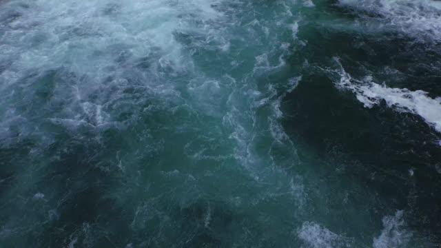 aerial: high angle view of water splashing in cascade, drone flying over waterfall - krka, croatia - 泡立つ波点の映像素材/bロール