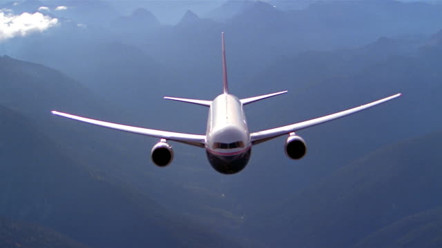 aerial high angle wide shot plane flying in air - commercial aircraft stock videos & royalty-free footage