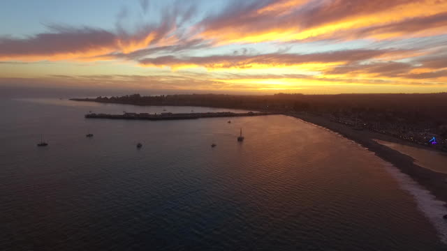 aerial high flyby: o'neill yacht charters at sunset - カリフォルニア州サンタクルーズ点の映像素材/bロール