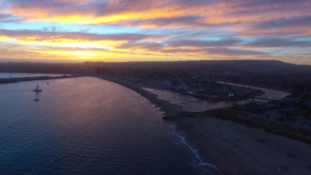 aerial high pan: sunset at santa cruz beach boardwalk - santa cruz california stock videos and b-roll footage