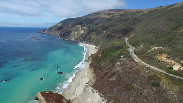 aerial high reverse reveal: 4k uhd little sur river mouth - carmel california stock videos and b-roll footage
