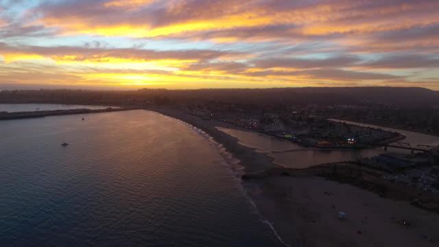 aerial high reverse: sunset at santa cruz beach boardwalk - santa cruz county california stock videos & royalty-free footage