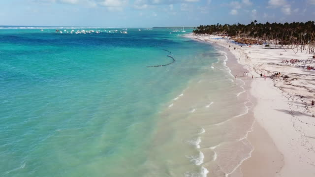 aerial: high up from ocean to beach in punta cana - punta cana stock videos and b-roll footage