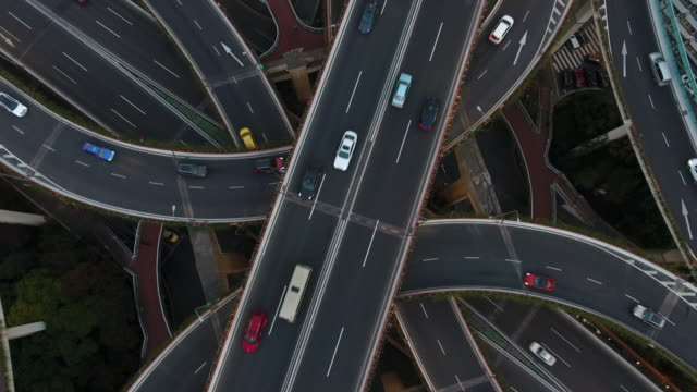 aerial highway junction at night - crossroad stock videos & royalty-free footage