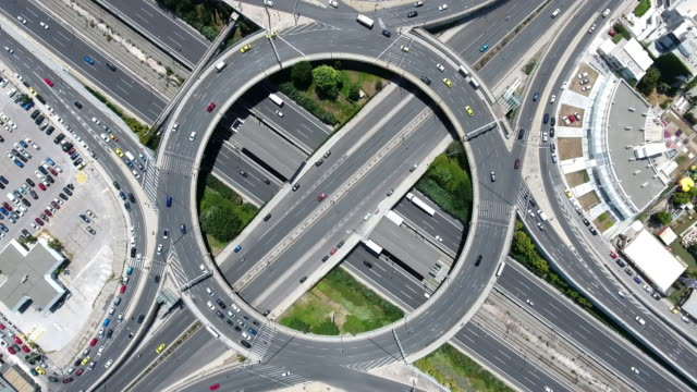 aerial highway junction - roundabout stock videos & royalty-free footage