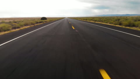 aerial pov highway vanishing point - sign stock videos & royalty-free footage