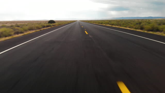 aerial pov highway vanishing point - vanishing point stock videos & royalty-free footage