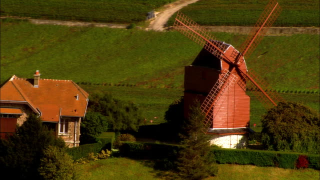 vidéos et rushes de aerial ws hilltop windmill and surrounding fields / verzenay, champagne region, france - patchwork landscape