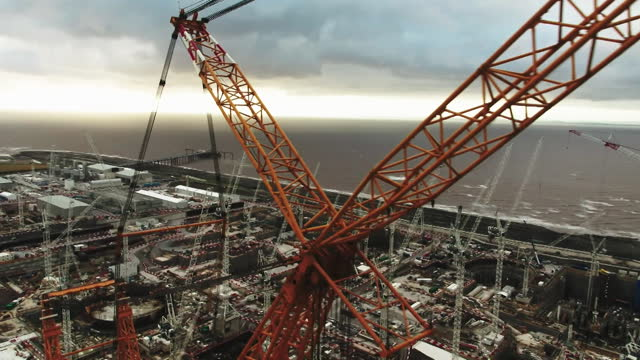 aerial hinkley point c nuclear power plant under construction in somerset - construction industry stock videos & royalty-free footage