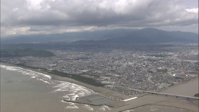 aerial hiratsuka city, tanzawa mountains in background - kanagawa prefecture stock videos and b-roll footage