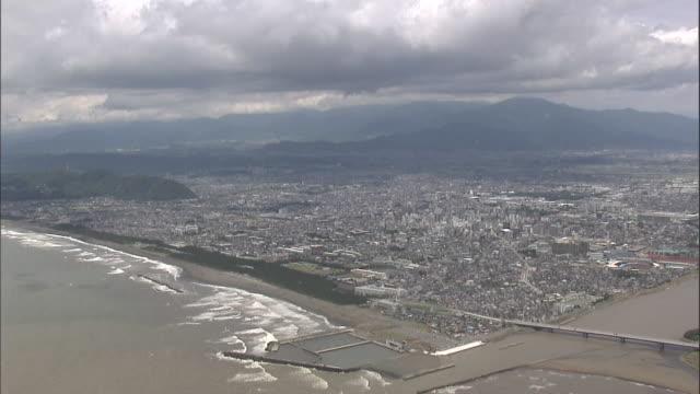 Aerial Hiratsuka City, Tanzawa Mountains In Background