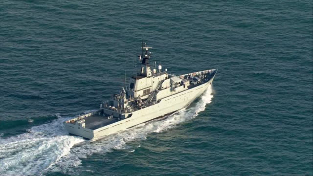 aerial hms mersey, an offshore patrol vessel, sailing off the coast of eastbourne - sailing stock videos & royalty-free footage