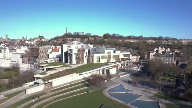 aerial holyrood parliament building, edinburgh - western europe stock videos & royalty-free footage