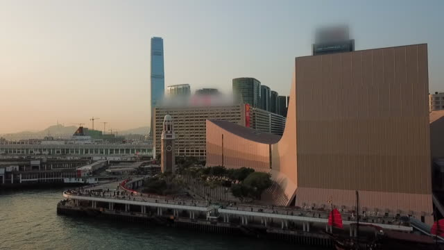 stockvideo's en b-roll-footage met aerial: hong kong cultural centre and clock tower at waterfront - star ferry