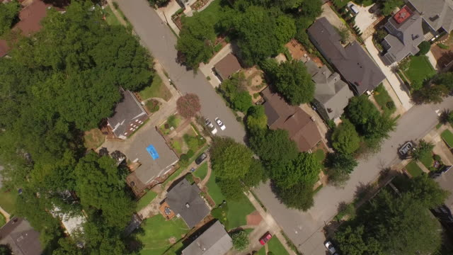 4K Aerial Hood flying over church - drone aerial video city views in 4k beautiful reveal with traffic and homes in view
