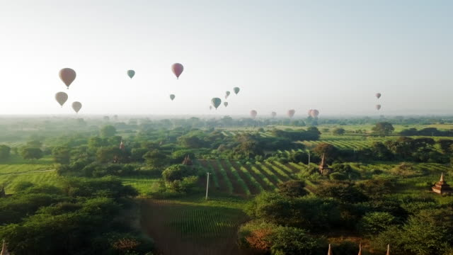 aerial: hot air balloons flying over the temples of old bagan - myanmar stock-videos und b-roll-filmmaterial