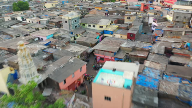 aerial: houses in slum against sky - mumbai, india - residential district stock videos & royalty-free footage