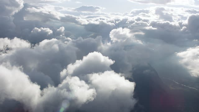 aerial hovering amongst the clouds above the swiss alps - helicopter point of view stock videos & royalty-free footage