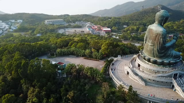 aerial: huge statue of buddha and surrounding landscape, lantau island, hong kong - surrounding stock videos & royalty-free footage