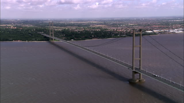aerial humber bridge over estuary / east riding, england - hull stock videos & royalty-free footage