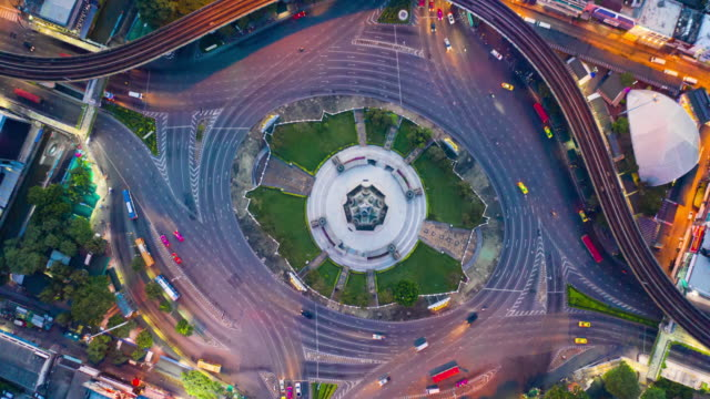 aerial hyper lapse at victory monument landmark of bangkok, thailand - roundabout stock videos & royalty-free footage