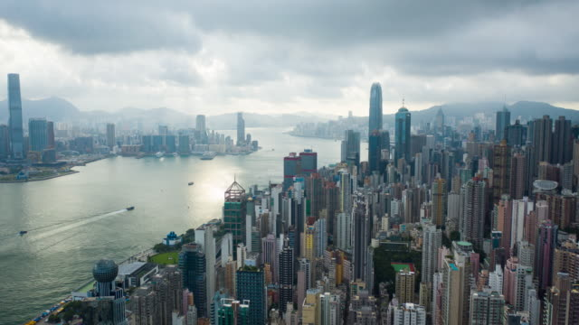 aerial hyper lapse of building exterior central district at victoria harbour and waterfront, hong kong - central bezirk hongkong stock-videos und b-roll-filmmaterial