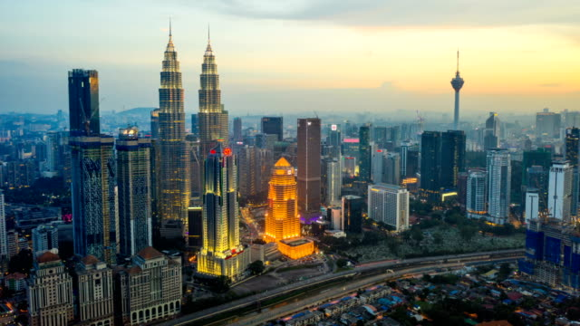 aerial  hyper lapse of kuala lumpur skyline at dusk - tower stock videos & royalty-free footage
