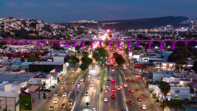 aerial hyper lapse of queretaro skyline - traffic time lapse stock videos & royalty-free footage
