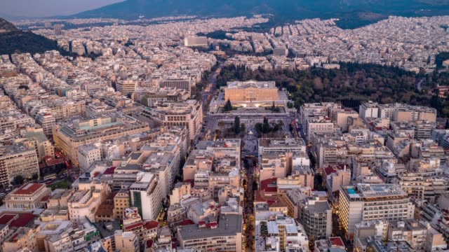 aerial hyperlapse of athens, greece, syntagma square and acropolis, people, cars, clouds - athens greece stock videos & royalty-free footage