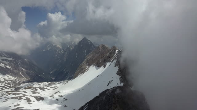 aerial hyperlapse of cloudy mountains of zugspitze germany - munich, germany - weather stock videos & royalty-free footage