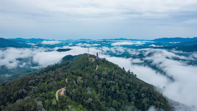 aerial hyperlapse of fog rolls across flowing over mountains - telecommunications equipment stock videos & royalty-free footage