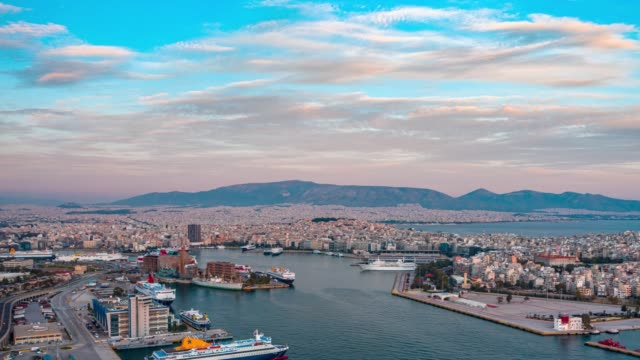 aerial hyperlapse of the piraeus port in athens, greece, at sunset - athens greece stock videos & royalty-free footage