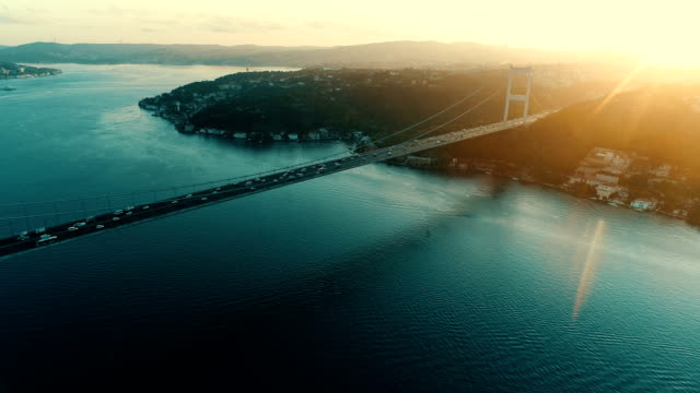 aerial hyperlapse of traffic over bridge - drone shots of fatih sultan mehmet bridge on istanbul bosphorus at sunrise - istanbul stock videos & royalty-free footage
