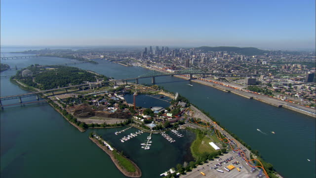 Aerial WS Ile St-Helene and La Ronde Amusement Park in St. Lawrence River, with Pont Jacques Cartier, Molson Brewery, and downtown cityscape / Montreal, Quebec, Canada
