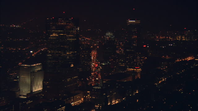 aerial ws illuminated back bay office buildings / boston, massachusetts, usa - back bay boston stock videos & royalty-free footage