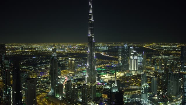 aerial illuminated burj khalifa business bay dubai creek - burj khalifa stock videos & royalty-free footage