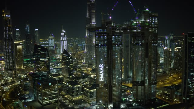 aerial illuminated burj khalifa business bay dubai creek - financial district stock videos & royalty-free footage
