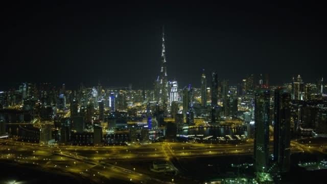 aerial illuminated coastal highway city skyscrapers dubai uae - burj khalifa stock videos & royalty-free footage